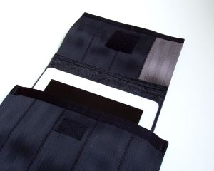 The C-5 is sized for an iPad. Pull on the flap to lift your device out of the case.