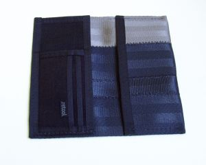 Our long wallet features a slot for bills or a checkbook on one side and card slots on the other.