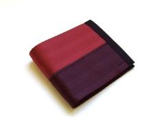 Billfold wallet in dark red and oxblood.