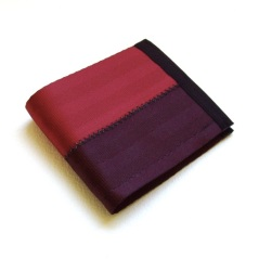 Billfold wallet in dark red and oxblood.