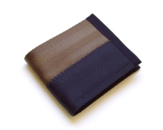 Billfold wallet in black and brown.