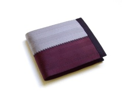 Billfold wallet in oxblood and grey.