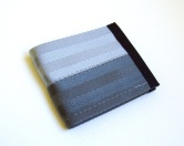 Billfold wallet in olive drab and silver.