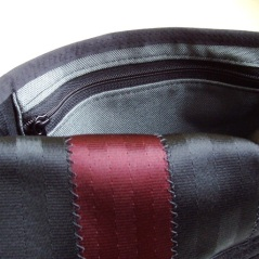 The M-6 in black and oxblood with an interior zipper pouch.
