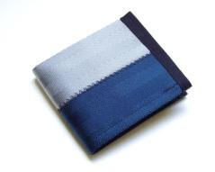 Billfold wallet in dark blue and grey.