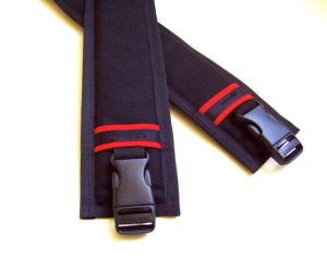 Padded straps with fancy red stripes.