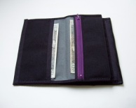 Two large slots for paper money / receipts plus another lined zippered pocket.