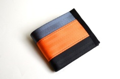 steel-black-orange- seatbelt wallet